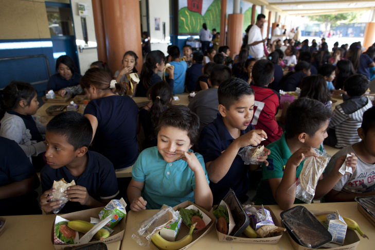Kitty Chora, 8, gets lunch at Gratts Learning Academy for Young Scholars in Los Angeles. The Los Angeles Unified School District is starting a program that brings food produced within 200 miles of Los Angeles to area schools every Thursday.