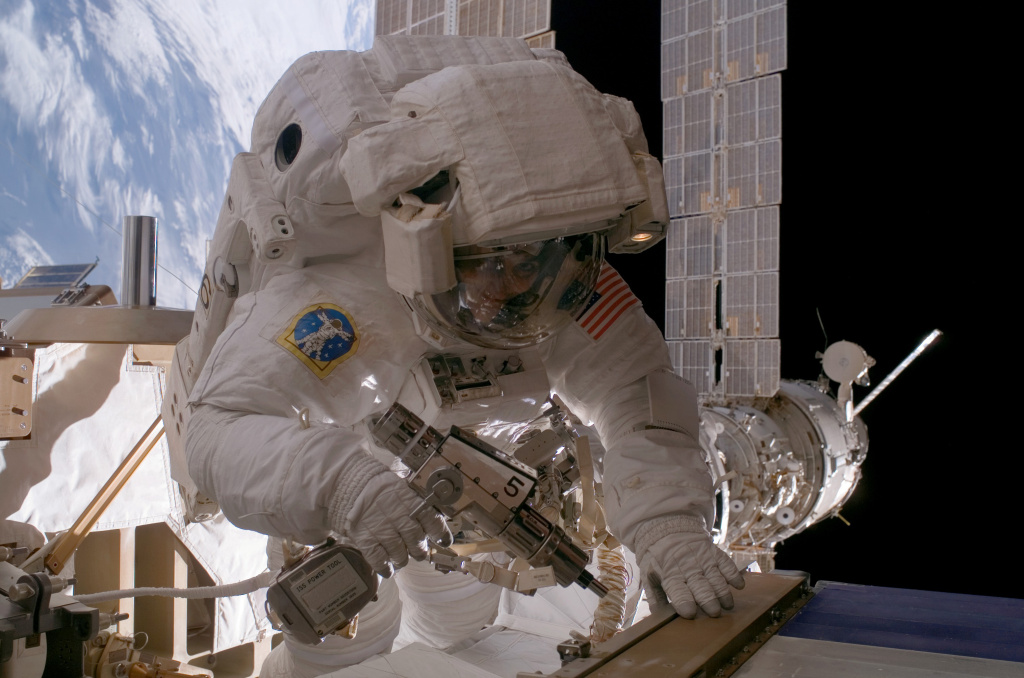 In this file photo, Astronaut Sunita L. Williams, Expedition 14 flight engineer, used a pistol grip tool as she worked on the International Space Station in a 7-hour 55-minute spacewalk that took place on Jan. 31, 2007. NASA astronaut Kjell Lindgren and NASA's one-year spaceman, Scott Kelly, the station's commander, were about two hours into a planned 6½-hour spacewalk on Friday when ammonia flakes spewed out.