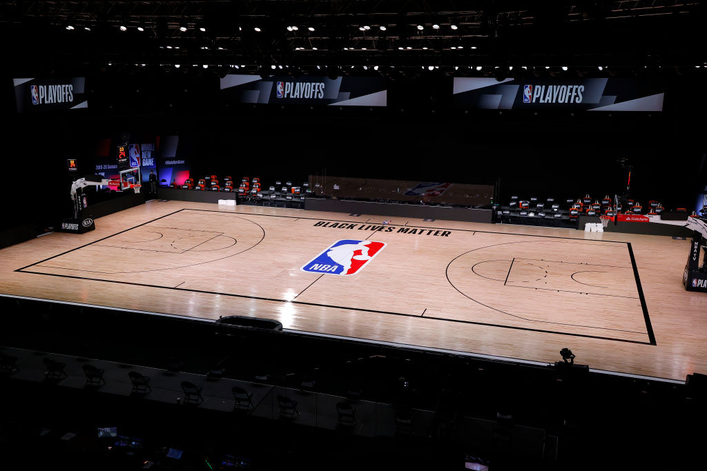 An empty court and bench is shown with no signage following the scheduled start time in Game Five of the Eastern Conference First Round between the Milwaukee Bucks and the Orlando Magic during the 2020 NBA Playoffs at AdventHealth Arena at ESPN Wide World Of Sports Complex on August 26, 2020 in Lake Buena Vista, Florida.