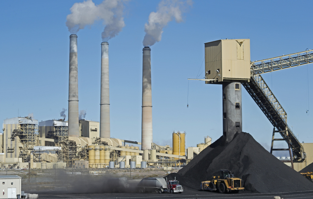 A truck delivers coal to Pacificorp's 1440 megawatt coal-fired power plant on October 9, 2017 in Castle Dale, Utah.