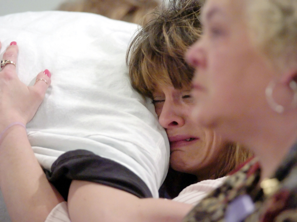 Angie Bryant, mother of nine-year-old Jessica Lunsford, cries as she receives a hug during a memorial service for her daughter March 19, 2005 in Lebanon, Ohio. Jessica Lunsford was abducted and murdered in Florida. The Jessica Lunford Act also known as