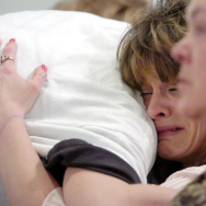"Angie Bryant, mother of nine-year-old Jessica Lunsford, cries as she receives a hug during a memorial service for her daughter March 19, 2005 in Lebanon, Ohio. Jessica Lunsford was abducted and murdered in Florida. The Jessica Lunford Act also known as ""Jessica's Law"" was enacted following the tragedy."