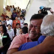 Khmer Rouge survivors, Soum Rithy, left, and Chum Mey, right, embrace each other after the verdicts were announced, at the U.N.-backed war crimes tribunal in Phnom Penh, Cambodia.