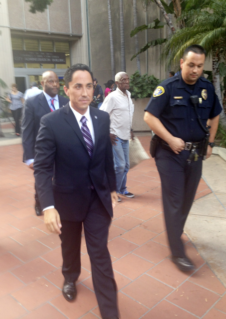 Interim San Diego Mayor Todd Gloria leaves City Hall Friday Aug. 30, 2013, after inspecting his new office in San Diego. Gloria assumed the role at 5 p.m. PDT, when Bob Filner's resignation took effect. Filner resigned amid numerous complaints of sexual harassment.(AP Photo/Elliot Spagat)