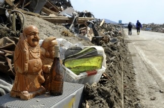 Salvaged sculptures are placed beside a road in Rikuzentakata, Iwate prefecture on March 29, 2011. The earthquake and tsunami that struck Japan caused at least $200 billion in damage, estimate officials.