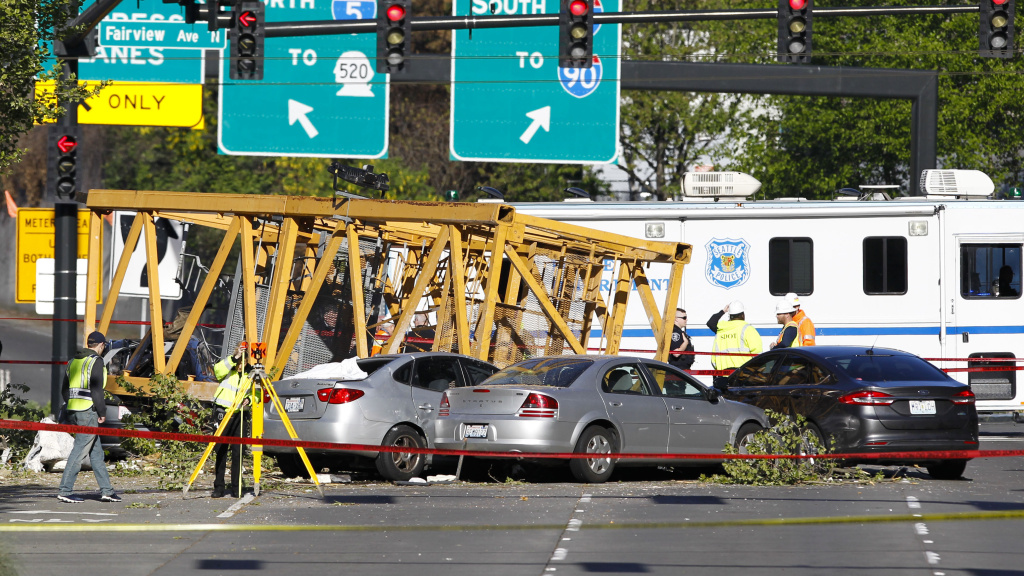 Emergency crews work at the scene of a construction crane collapse on Saturday in Seattle. Four people were killed.