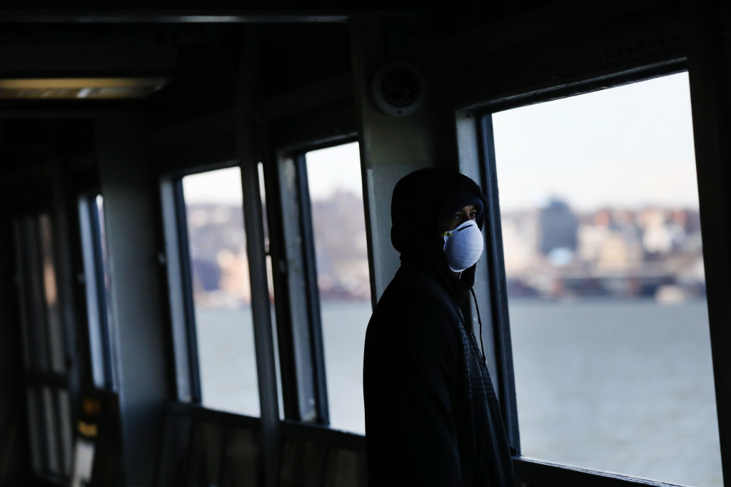 Tremaine Fredericks rides on an empty Staten Island Ferry to Manhattan on March 24, 2020 in New York City.
