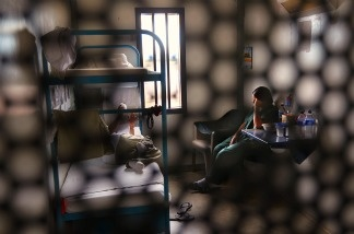 Immigrants sit in their housing cell in the women's wing of a detention facility in Eloy, Arizona on July 30, 2010.
