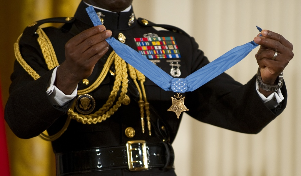 A military aide holds up the Medal of Honor as US President Barack Obama awards US Marine Corps Sgt. Dakota Meyer in Washington, DC.