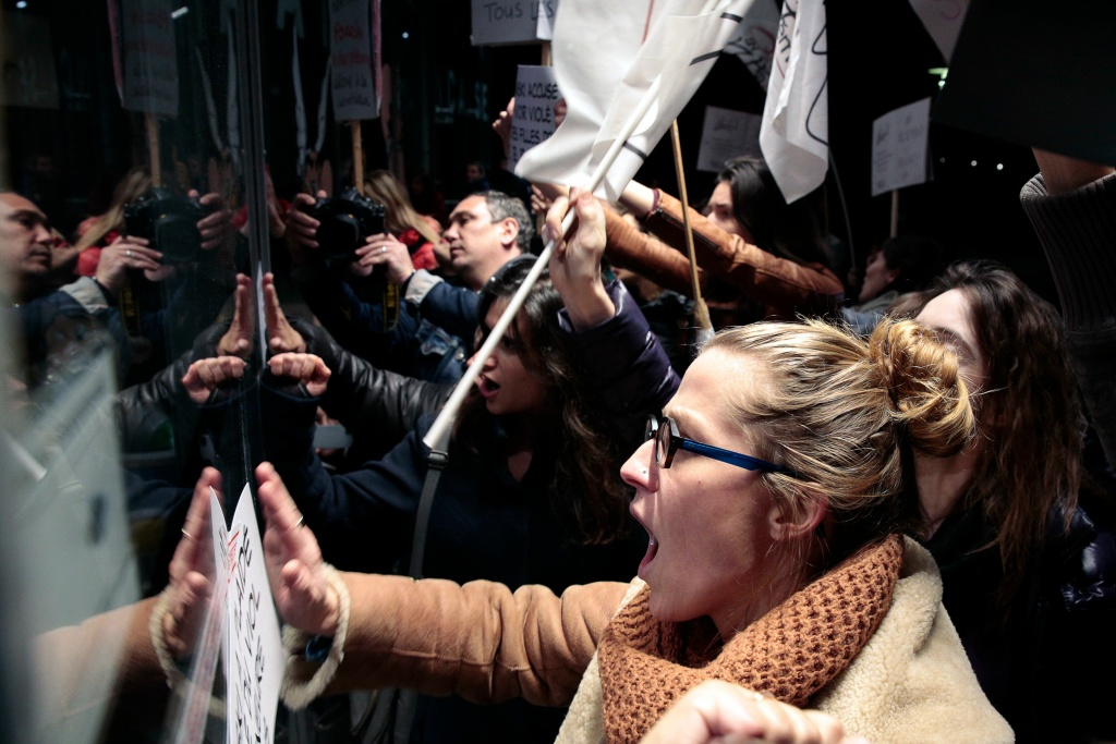 Protesters hit a window during a demonstration on October 30, 2017, outside the Cinematheque Francaise film archive in Paris, where filmmaker Roman Polanski, accused of a string of sexual assaults, was expected to attend a retrospective of his work.