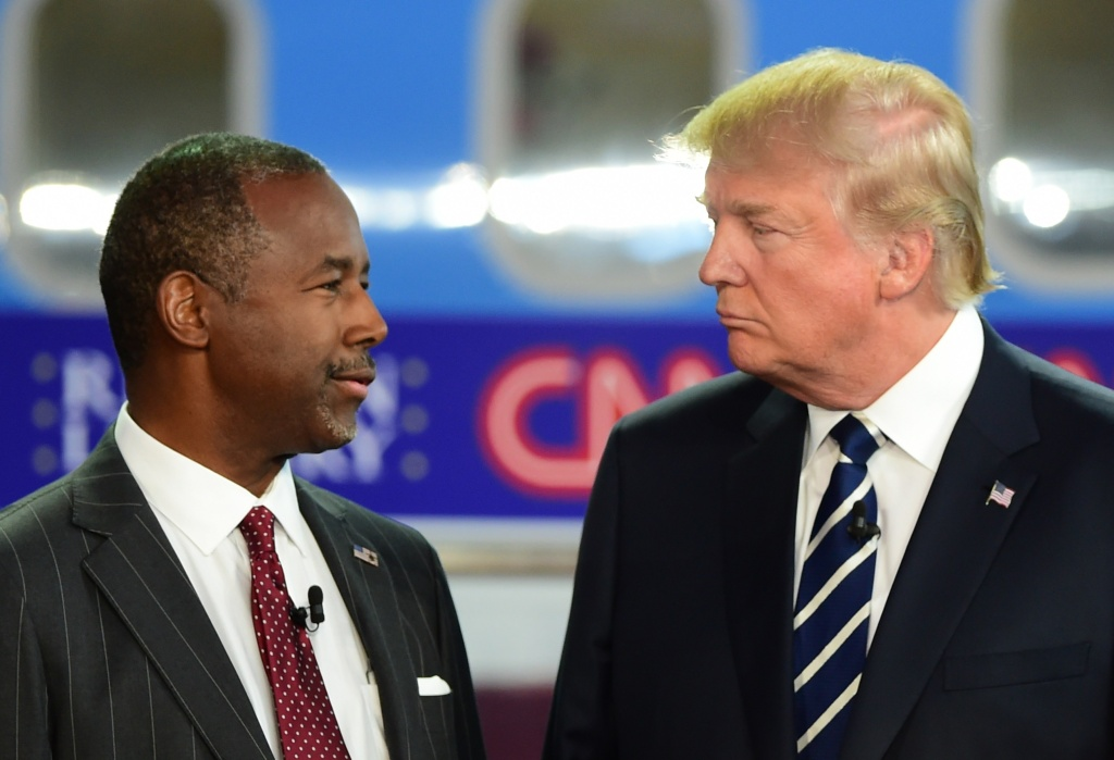 Republican presidential hopefuls Ben Carson (L) and Donald Trump look on during the Republican Presidential Debate at the Ronald Reagan Presidential Library in Simi Valley, California.