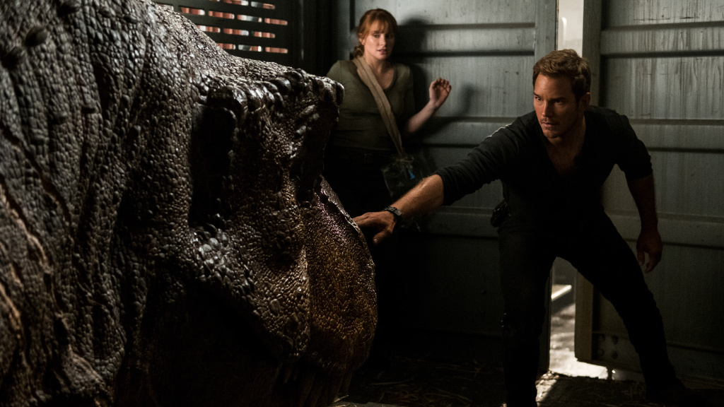 Sleep Dino More: Claire (Bryce Dallas Howard) and Owen (Chris Pratt) try not to wake one of Isla Nublar's grumpiest residents in <em>Jurassic World: Fallen Kingdom</em>.
