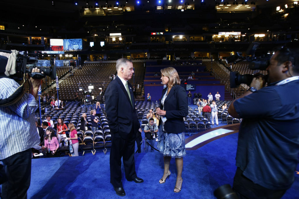 DNC Howard Dean (L) is interviewed by CBS news anchor Katie Couric at the site of the Democratic National Convention (DNC) at the Pepsi Center August 24, 2008 in Denver, Colorado.