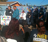 Parents gather at a Compton backyard ready to petition Compton Unified to turn low-performing McKinley Elementary into a charter school under the new, so-called