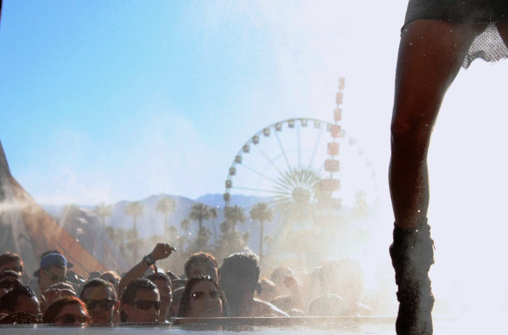 Fans try to cool down during the sizzling second weekend of the Coachella festival.