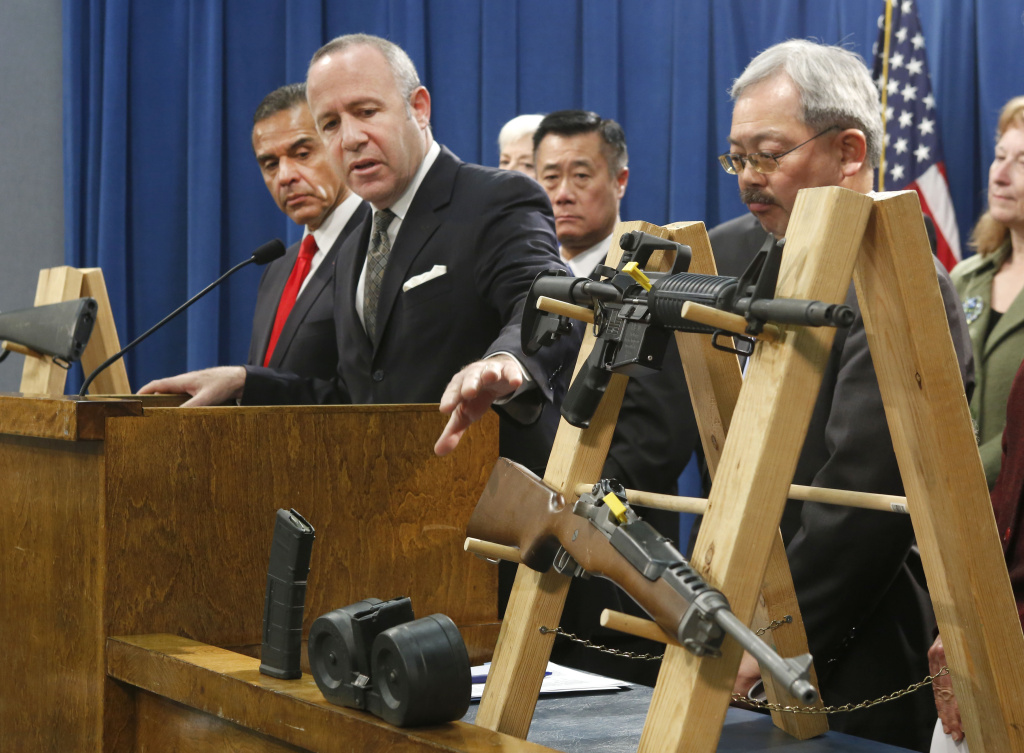 In this Feb. 7, 2013 file photo, Senate President Pro Tem Darrell Steinberg, second from left,  gestures to a pair of semi-automatic rifles as he discusses a package of proposed  gun control legislation at a Capitol news conference in Sacramento, Calif.  Gov. Jerry Brown vetoed Steinbergs's SB374 which would have banned future sales of most semi-automatic rifles that accept detachable magazines, Friday, Oct. 11, 2013.