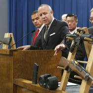 "In this Feb. 7, 2013 file photo, Senate President Pro Tem Darrell Steinberg, second from left,  gestures to a pair of semi-automatic rifles as he discusses a package of proposed  gun control legislation at a Capitol news conference in Sacramento, Calif.  Gov. Jerry Brown vetoed Steinberg's SB374 which would have banned future sales of most semi-automatic rifles that accept detachable magazines, Friday, Oct. 11, 2013. Last Friday, Steinberg said that SB374 ""should be reconsidered."""