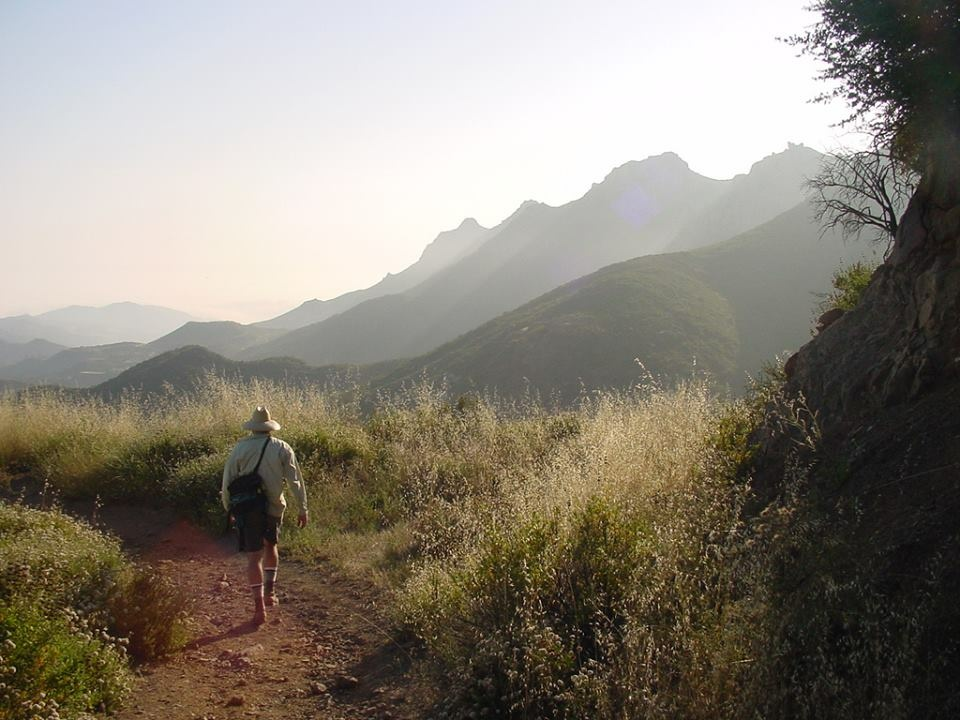 A hiker walks along the Backbone Trail in the Santa Monica Mountains National Recreation Area.