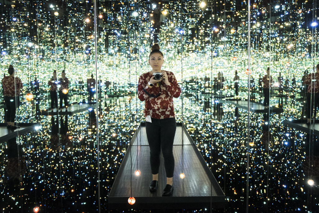 KPCC Visual Journalist Maya Sugarman takes pictures inside The Broad's own installation,