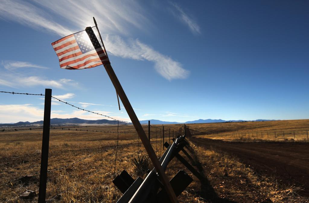 An American flag flies at the U.S.-Mexico border on February 26, 2013 near Sonoita, Arizona