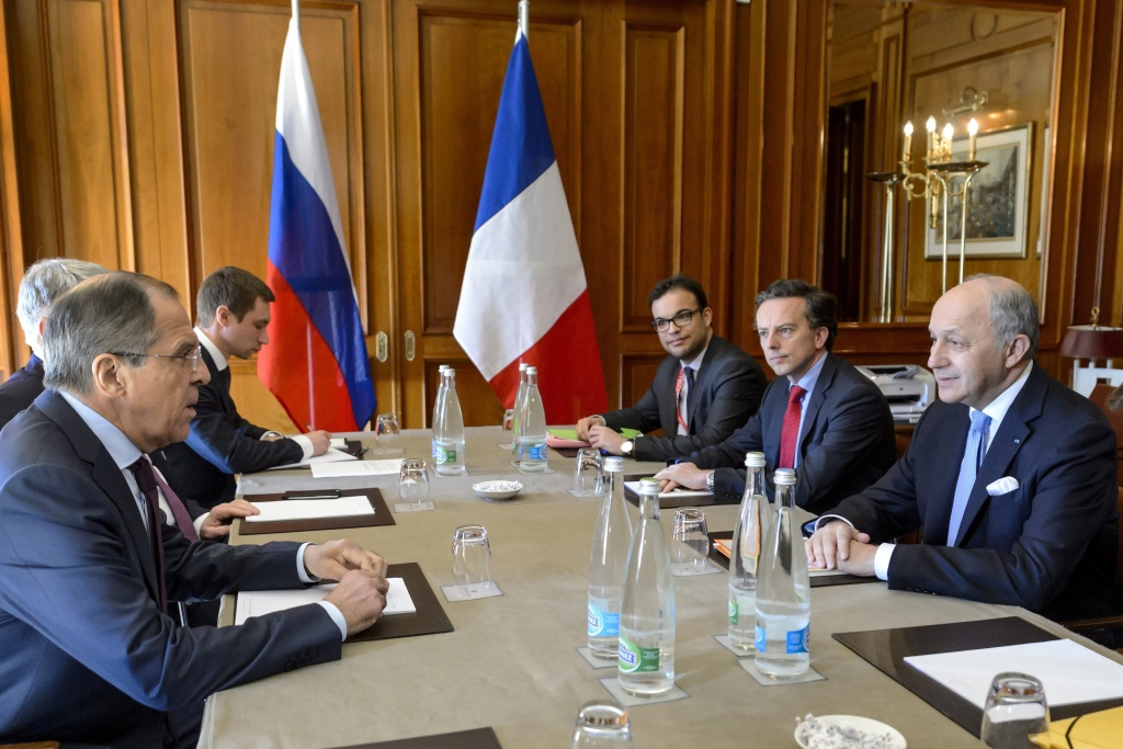 French Foreign Minister Laurent Fabius (R) sits with members of his delegation as meets Russian Foreign Minister Sergei Lavrov (L) and members of his delegation during Iran nuclear talks, on March 30, 2015 in Lausanne. The top diplomats of Iran and the United States, China, Russia, Britain, France and Germany aim by the end of March 31 to agree the outlines of a deal curtailing Iran's nuclear programme.