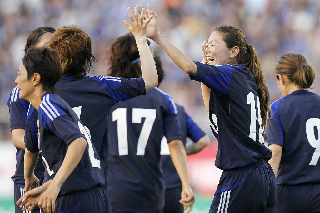 TOKYO, JAPAN - JULY 11:  Homare Sawa (2nd R) of Japan celebrates her goal against Australia with her team-mates during the women's international friendly match between Japan and Australia at the National Stadium on July 11, 2012 in Tokyo, Japan. The team was flown to the Olympics in coach, while the men's team was flown in first class. (Photo by Kiyoshi Ota/Getty Images)