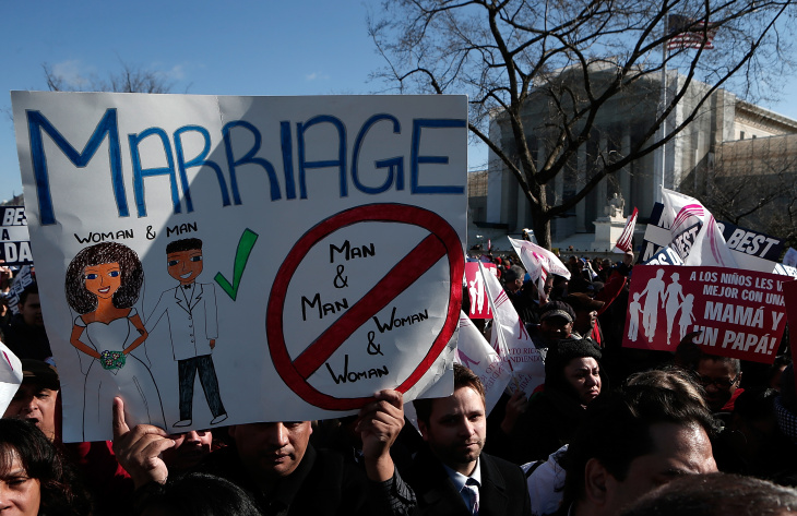 Supporters of Proposition 8 demonstrate in front of the U.S. Supreme Court on March 26, 2013 in Washington, DC. The Supreme Court is hearing arguments March 26, in California's proposition 8, the controversial ballot initiative that defines marriage only between a man and a woman.