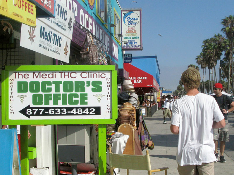 Signs like this are beginning to crowd the Venice Beach Boardwalk, but you may not want to get your annual physical here.