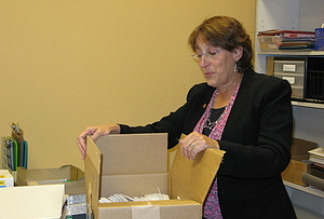 Illinois State Rep. Sandy Cole unpacks boxes and arranges her new district office, after being evicted from her longtime office because the state fell so far behind in paying the rent.