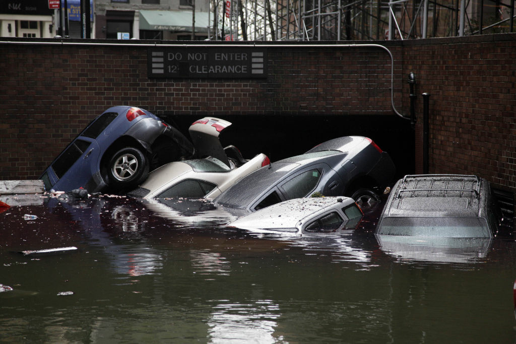 Cars are submerged at the entrance to a parking garage in New York's Financial District in the aftermath of superstorm Sandy, Tuesday, Oct. 30, 2012. New York City awakened Tuesday to a flooded subway system, shuttered financial markets and hundreds of thousands of people without power a day after a wall of seawater and high winds slammed into the city, destroying buildings and flooding tunnels.