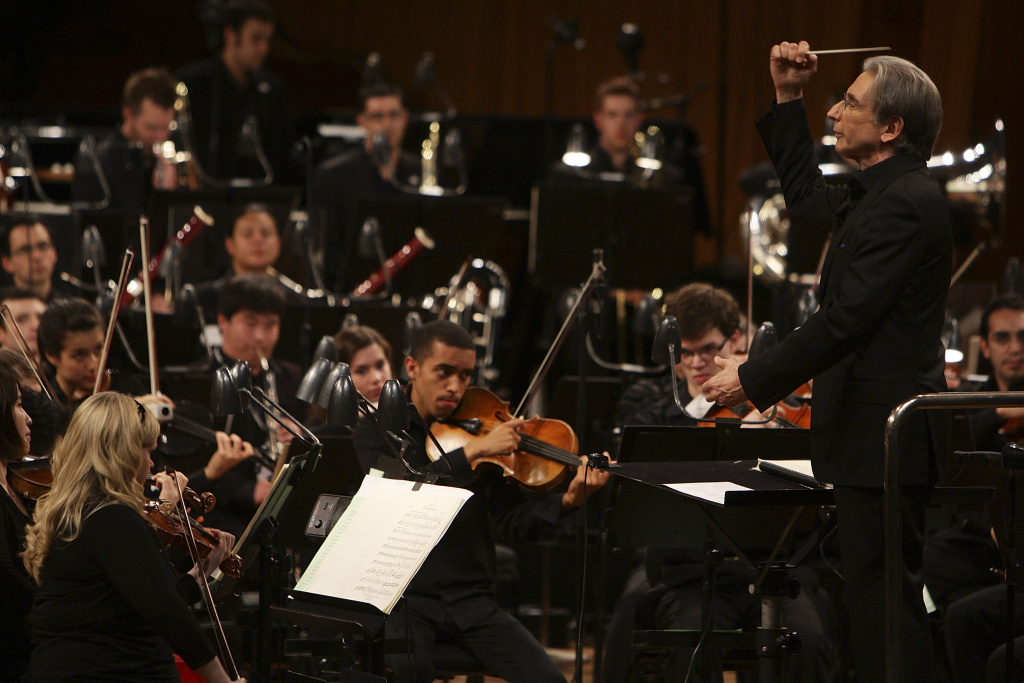 Conductor Michael Tilson Thomas performs on stage with the YouTube Symphony Orchestra at Sydney Opera House on March 20, 2011 in Sydney, Australia.
