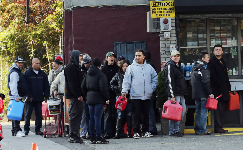 People wait on line on East Houston Street in Lower Manhattan following Superstorm Sandy on November 4, 2012, in New York City. The wait time was only forty minutes when purchasing with smaller amounts in just a gas can. With the death toll currently over 100 and millions of homes and businesses without power, the U.S. East Coast is attempting to recover from the effects of floods, fires and power outages brought on by Superstorm Sandy.
