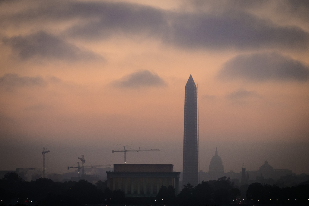 Low clouds and fog roll across Washington at sunrise Tuesday, Oct. 15, 2013 as Congress continues to negotiate their way free from the budget standoff that has shutdown many part of the U.S. government for 15 days.