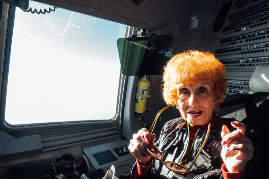 Elinor Otto enjoys her first flight aboard a C-17 after a 50-year career assembling military planes at the Long Beach Boeing plant.