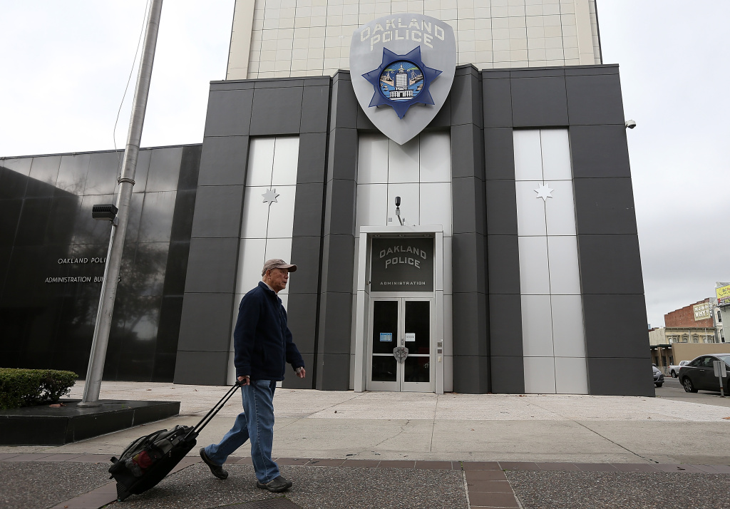 A man walks by the Oakland Police headquarters on December 6, 2012 in Oakland, California.