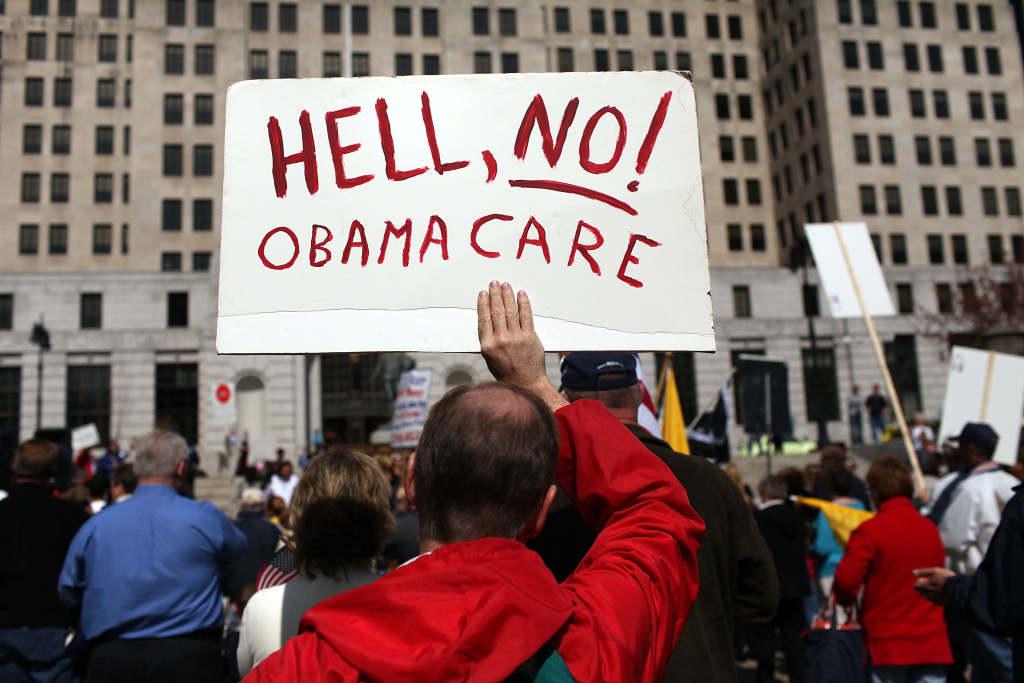 A participant at a Tea Party Express rally displays a sign critical of the Obama administration on April 13, 2010 in Albany, New York.  The Tea Party Express will head to Boston on Wednesday where the headline speaker at an afternoon rally will be Sarah Palin. The group will conclude its national tour in Washington, D.C. Thursday with a Tax Day rally at the Washington Monument.