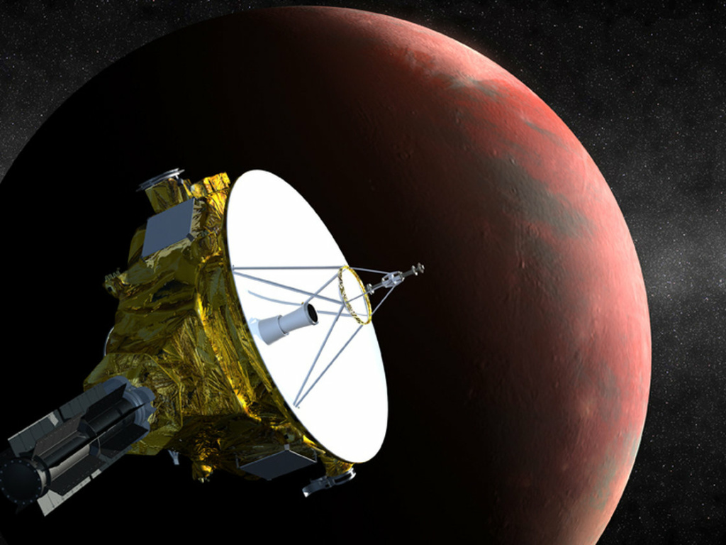 An artist's concept shows the New Horizons spacecraft as it approaches Pluto and its largest moon, Charon, in July 2015.