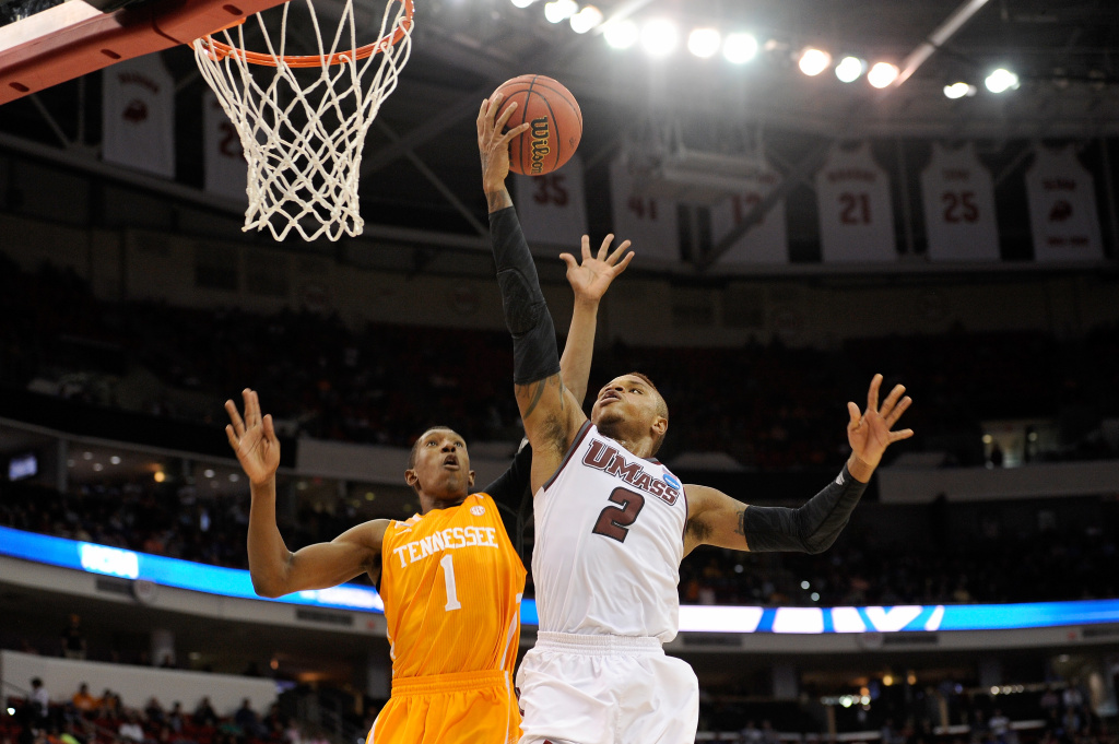 Derrick Gordon #2 of the Massachusetts Minutemen goes up for a shot against Josh Richardson #1 of the Tennessee Volunteers in the second round of the 2014 NCAA Men's Basketball Tournament at PNC Arena on March 21, 2014 in Raleigh, North Carolina.