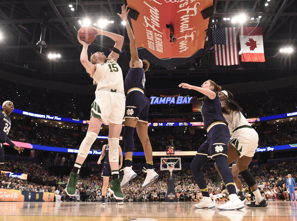 Lauren Cox (#15) of the Baylor Bears shoots over Brianna Turner (#11) of the Notre Dame Fighting Irish at Amalie Arena Sunday night in Tampa, Fla.