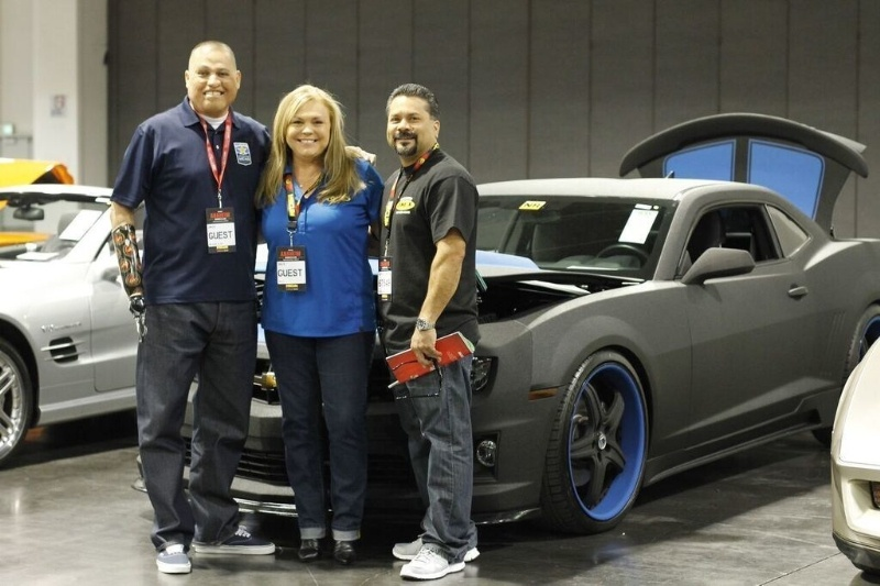 Preparing for the auction of the LINE-X Camaro with proceeds donated to Operation Mend. From the left: Operation Mend veteran Octavio Sanchez, LINE-X's Director of Marketing Teppy Wigington and LINE-X of Torrance franchisee Herb Grageda. (PRNewsFoto/LINE-X)