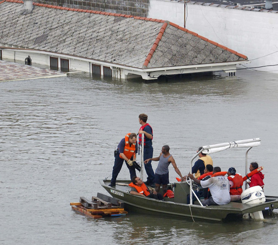 Emergency personnel rescue residents fro