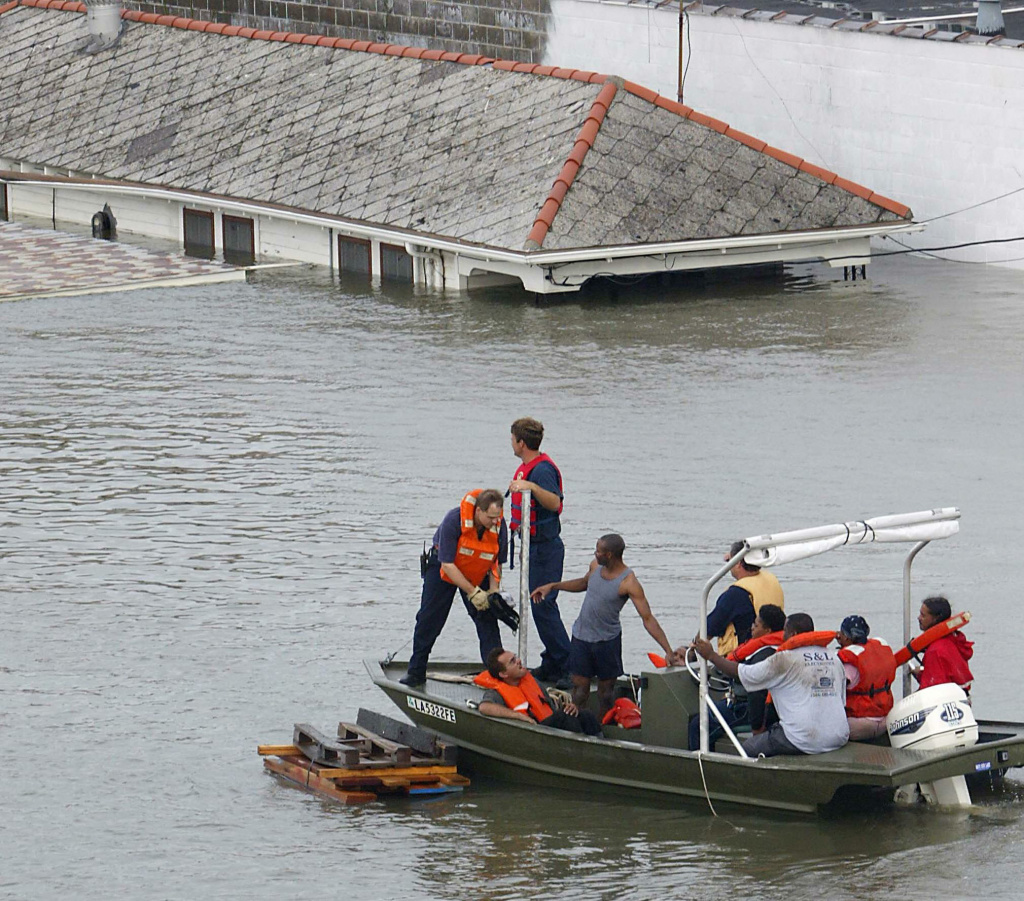 Emergency personnel rescue residents from submerged houses in New Orleans, 29 August 2005, after Hurricane Katrina made landfall. Hurricane Katrina made landfall early Monday as a category four storm on the five-level Saffir-Simpson hurricane intensity scale and caused widespread damage and flooding in New Orleans and other cities on the southern Gulf Coast of the United States.