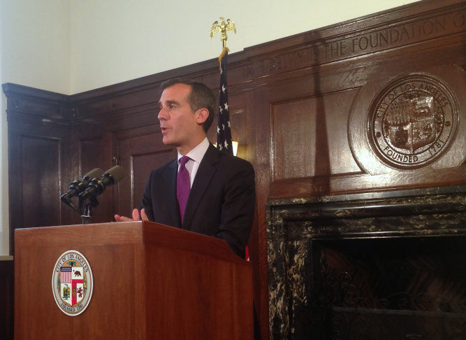 Los Angeles Mayor Eric Garcetti takes questions from the media about the Police Commission's ruling on the Ezell Ford shooting during a news conference in Los Angeles, Tuesday, June 9, 2015. The Los Angeles Police Commission has found that one officer acted within policy but the other violated it in the fatal close-range shooting shooting death of Ezell Ford last year. (AP Photo/Tami Abdollah)