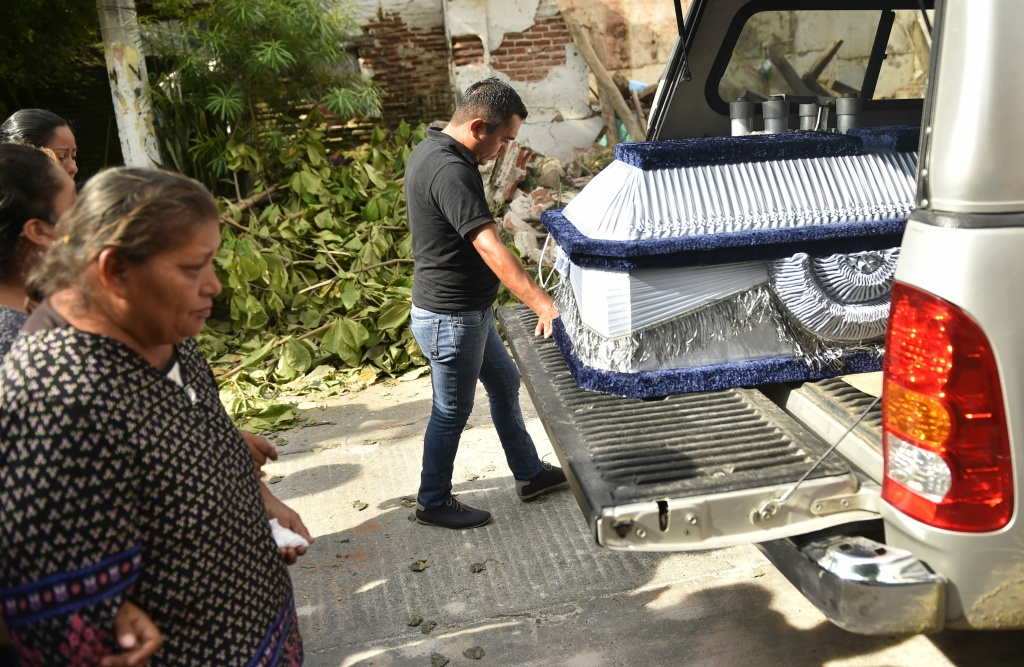 The coffin of 85-year-old Casimiro Rey, one of the victims of an 8.1 magnitude earthquake that hit Mexico's Pacific coast, is accompanied on the way to his funeral on September 8, 2017 in Juchitan de Zaragoza, Oaxaca.