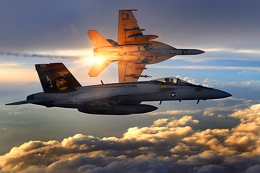Two U.S. Navy F/A-18 Super Hornets of Strike Fighter Squadron 31 fly a combat patrol over Afghanistan, Dec. 15, 2008.