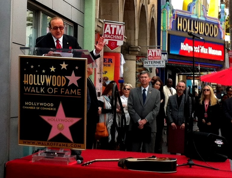 Legendary music executive Clive Davis speaking at the ceremony finally giving Janis Joplin a star on the Hollywood Walk of Fame. Joplin was the first artist Davis signed to Columbia Records.