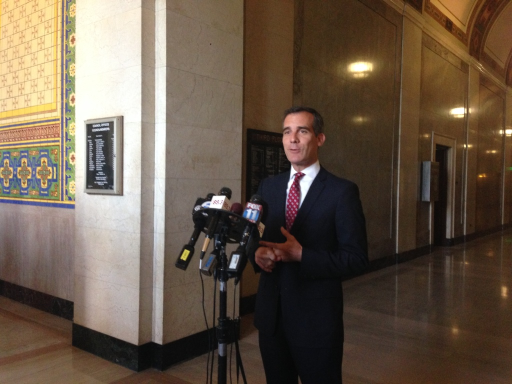 Mayor Eric Garcetti answers questions from the media at City Hall.