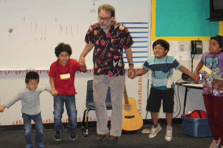 General music teacher Dan Wohlitz leads second graders at Rowland Elementary School in a song and movement exercise.
