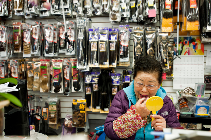 Mary Fernandez of Pasadena shops in the new Walmart in Altadena, which opened on March 1. Fernandez head about the new store from her English teacher. It is a 10-minute bus ride from her home.