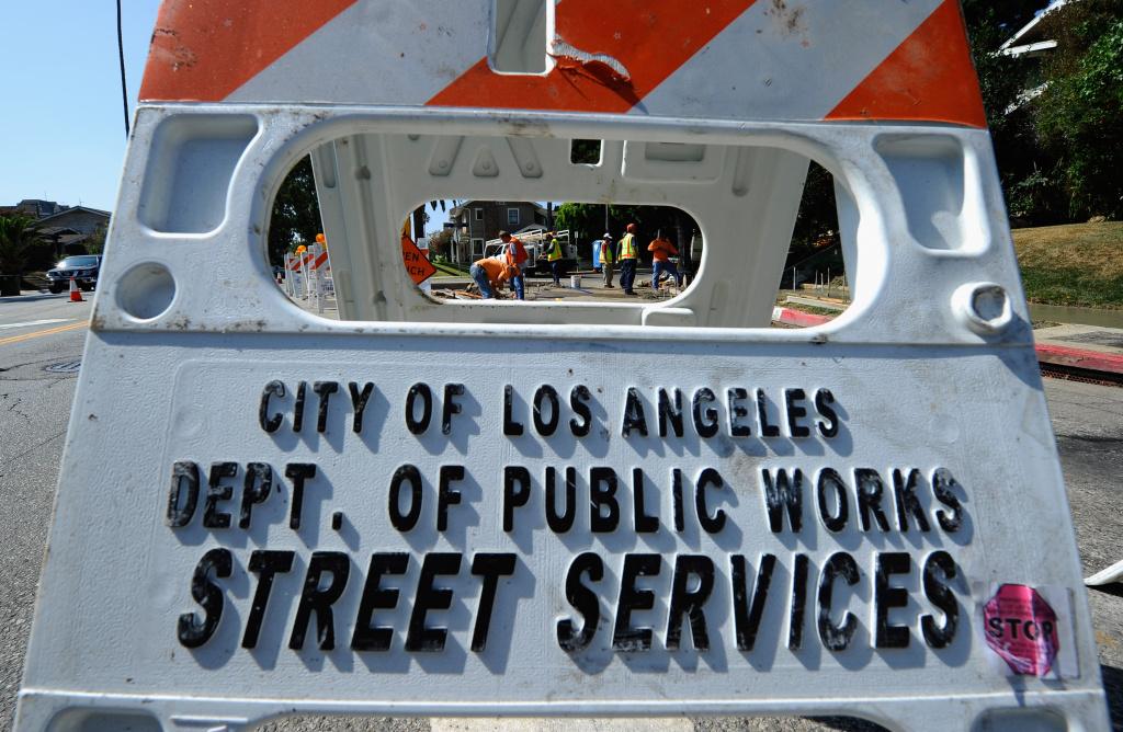 LOS ANGELES, CA - AUGUST 12:  City of Los Angeles Public Works Department Street Services workers repair a sidewalk on August 12, 2010 in Los Angeles, California.